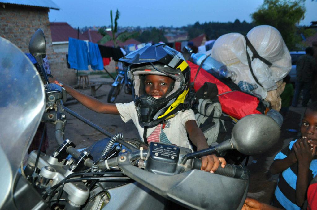 Happy little boy on a 1100 motorbike with