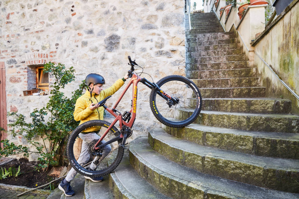 Boy lifting a bike