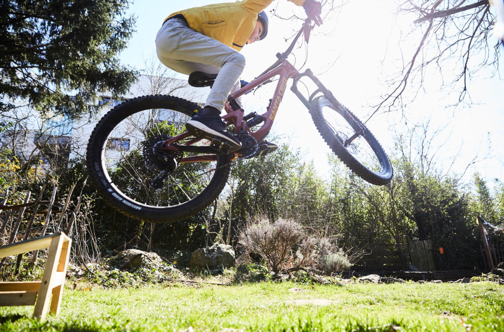 Boy jumping with a bike