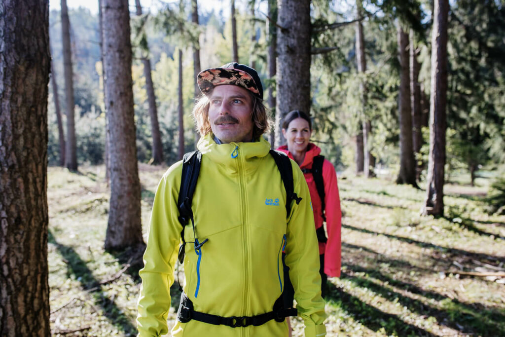 Mountain Guides in the forest dressed in Jack Wolfskin outdoor clothes