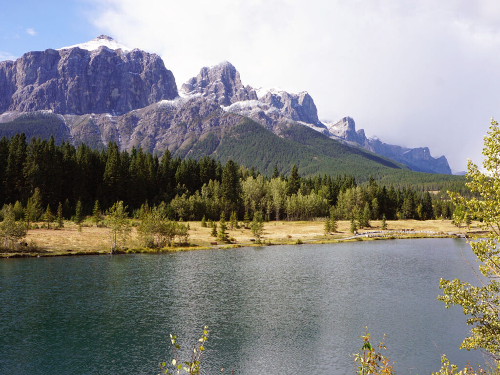sunny day in the Rocky Mountains with a lake and forest