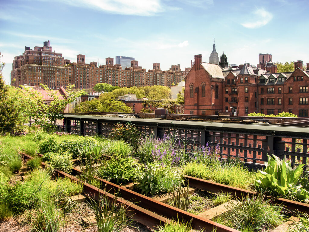 vertical gardens in New York City with train tracks and sky line
