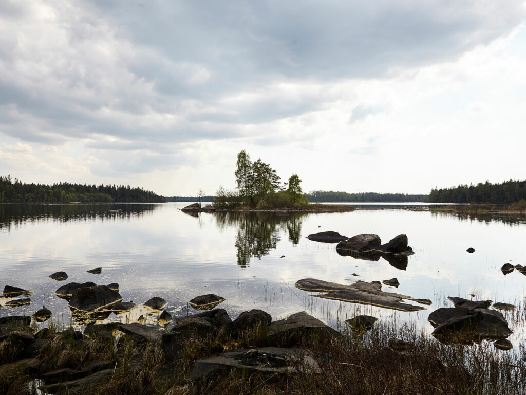 View of a Swedish lake with rocks and reflection of the sky