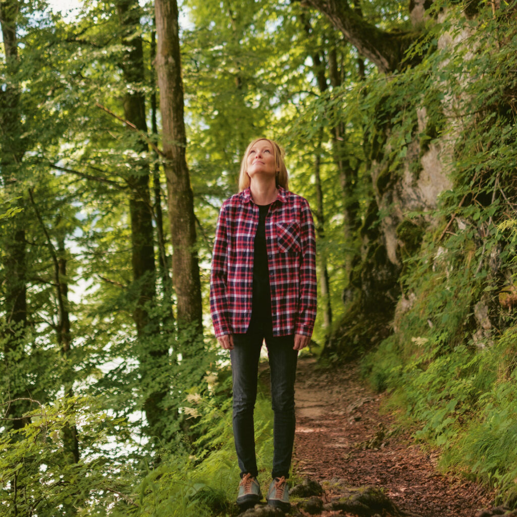 author and herbalist Sonja Greimel standing in the woods