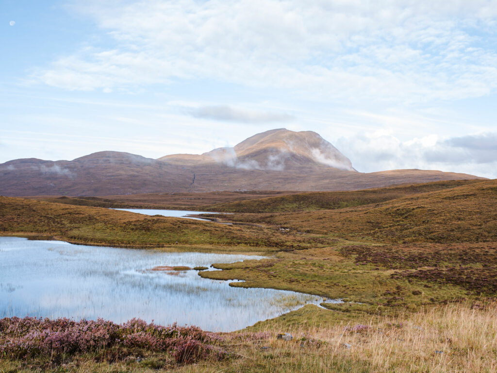 Scottish High Lands with small lake and hill top view