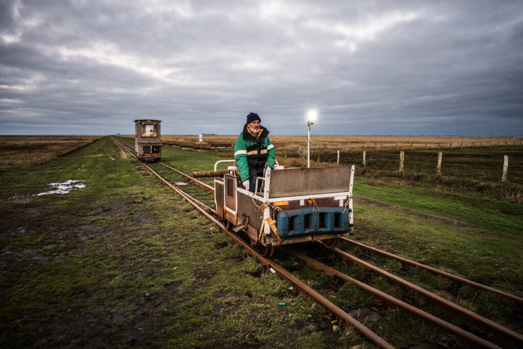 A light railway connects the Hallig Langeness to the mainland