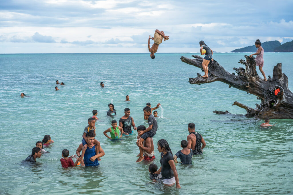 Kids playing in the ocean on Samoa