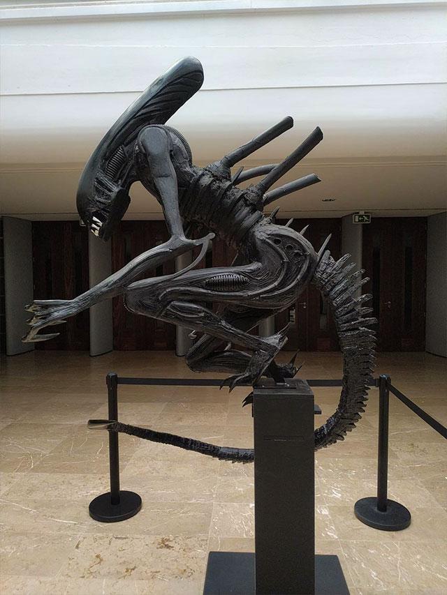 alien like figure made from trash