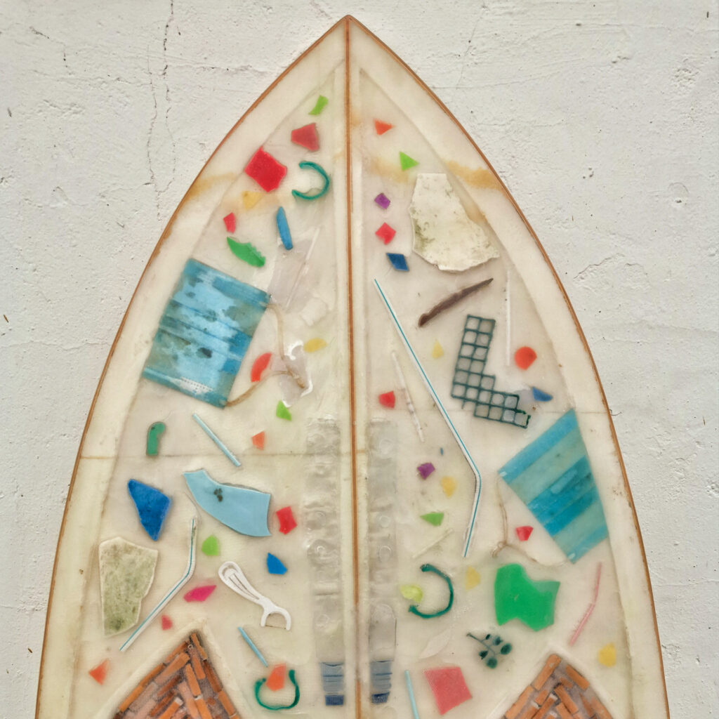 Trash Traveller surf board made entirely out of trash found at the beach